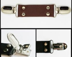 Brown leather cinch clip for dresses, jackets, or shirts with silver tone clips.